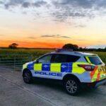rural crime image - police car sunset